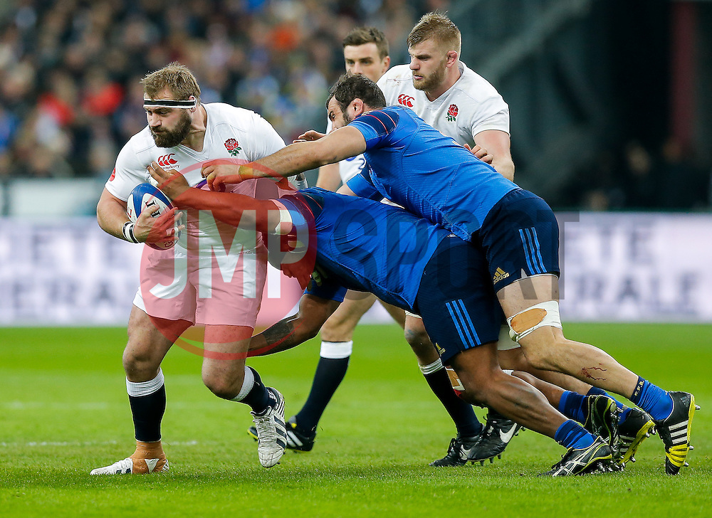 England replacement Joe Marler is tackled by France Prop Jefferson Poirot - Mandatory byline: Rogan Thomson/JMP - 19/03/2016 - RUGBY UNION - Stade de France - Paris, France - France v England - RBS 6 Nations 2016.