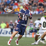 Ryan Boyle #14 of the Boston Cannons looks to pass the ball past Albert Maione #0 of the New York Lizards during the game at Harvard Stadium on July 19, 2014 in Boston, Massachusetts. (Photo by Elan Kawesch)