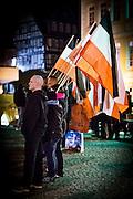 Frankfurt | 07 October 2016<br /> <br /> Am Freitag (07.10.2016) versammelten sich in Wetzlar etwa 80 Neonazis aus dem Umfeld der NPD, von neonazistischen Freien Kameradschaften, dem sog. Freien Netz Hessen und der Identit&auml;ren Bewegung zu einer Demonstration &quot;gegen &Uuml;berfremdung&quot;. Die geplante Demo-Route war von etwa 1600 Anti-Nazi-Aktivisten blockiert, daher wurde den Neonazis eine neue Demoroute durch Altstadt und Innenstadt von Wetzlar vorbei am Wetzlarer Dom zugewiesen. Auch hier stellten sich den Rechten immer wieder Aktivisten in den Weg.<br /> Hier: W&auml;hrend der Zwischenkundgebung der Neonazi-Demo stehen Neonazis mit Fahnen in Schwarz-Weiss-Rot vor dem Dom von Wetzlar.<br /> <br /> photo &copy; peter-juelich.com<br /> <br /> FOTO HONORARPFLICHTIG, Sonderhonorar, bitte anfragen!