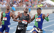 Jul 26, 2019; Des Moines, IA, USA; Christian Coleman (center) defeats Michael Rodgers (right) and Isiah Young to win the 100m in 9.99 during the USATF Championships at Drake Stadium.