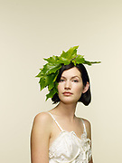 Portrait of woman 30-35, with decorative foliage head piece