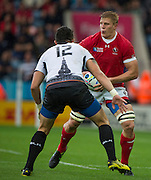 Leicester, Great Britain, Canadian Flanker John MOONLIGHT, looking to lay off teh ball, confronted by Florin VLAICU, during the Pool D game, Canada vs Romania.  2015 Rugby World Cup,  Venue, Leicester City Stadium, ENGLAND.  Tuesday    06/10/2015.   [Mandatory Credit; Peter Spurrier/Intersport-images]
