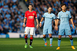 Angel Di Maria of Manchester United is marked by Pablo Zabaleta and Jesus Navas of Manchester City - Photo mandatory by-line: Rogan Thomson/JMP - 07966 386802 - 02/11/2014 - SPORT - FOOTBALL - Manchester, England - Etihad Stadium - Manchester City v Manchester United - Barclays Premier League.