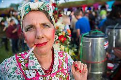 A tea lady in the interstage area. The 2015 Glastonbury Festival, Worthy Farm, Glastonbury.