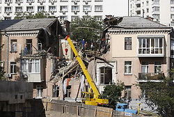 July 8, 2017 - Kiev, Ukraine - Rescue workers inspect the ruins of a three-store building, destroyed as a result of gas explosion in Kiev, Ukraine, 08 July, 2017. One man was died and six were wounded as a result of the accident, UNIAN agency report. (Credit Image: © Str/NurPhoto via ZUMA Press)