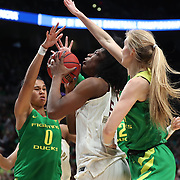 March 31, 2019; Portland, OR, USA;  Oregon Ducks forward Satou Sabally (0) and Oregon Ducks forward Lydia Giomi (14) defend Mississippi State Bulldogs center Teaira McCowan (15) in the first half of Elite Eight of the NCAA Women's Tournament at Moda Center.<br /> Photo by Jaime Valdez
