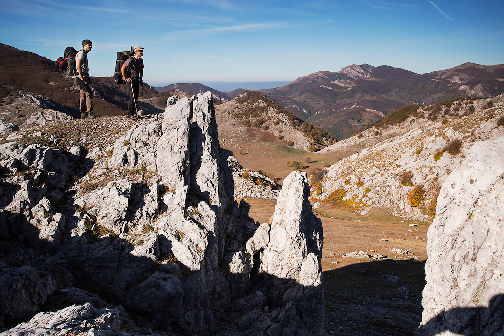 Hikers (Adrian Grancea, left & Dan Dinu) on limestone ridge in Mehedinti Plateau Geopark, Geoparcul Platoul Mehedinți, Romania.