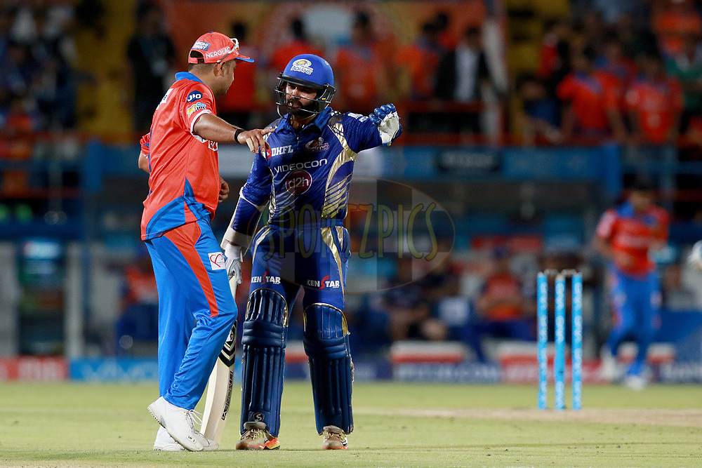 Suresh Raina  captain of GLand Parthiv Patel of MI during match 35 of the Vivo 2017 Indian Premier League between the Gujarat Lions and the Mumbai Indians  held at the Saurashtra Cricket Association Stadium in Rajkot, India on the 29th April 2017<br /> <br /> Photo by Rahul Gulati - Sportzpics - IPL