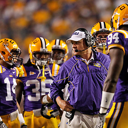 November 13, 2010; Baton Rouge, LA, USA; LSU Tigers head coach Les Miles talks to his players during the first half against the Louisiana Monroe Warhawks at Tiger Stadium.  Mandatory Credit: Derick E. Hingle