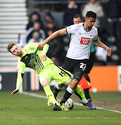 James Husband of Huddersfield Town (L) and Nick Blackman of Derby County in action - Mandatory byline: Jack Phillips/JMP - 05/03/2016 - FOOTBALL - iPro Stadium - Derby, England - Derby County v Huddersfield Town - Sky Bet Championship