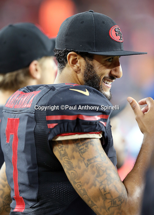 San Francisco 49ers quarterback Colin Kaepernick (7) has a laugh on the sideline during the 2015 NFL week 1 regular season football game against the Minnesota Vikings on Monday, Sept. 14, 2015 in Santa Clara, Calif. The 49ers won the game 20-3. (©Paul Anthony Spinelli)