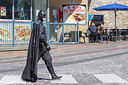 UNITED KINGDOM, London: 24 May 2019 <br /> A man dressed as Batman walks across the road as he makes his way to the ExCeL Centre in London earlier today for the MCM London Comic Con. Thousands of cosplay enthusiasts will come to the ExCeL Centre across the next three days to enjoy the convention.