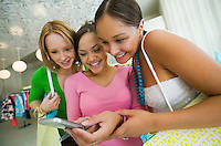 Three Girls Looking at Cell Phone picture