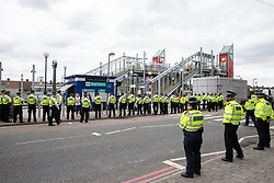 London, UK. 3 September, 2019. Activists, primarily from faith groups including a significant number of Quakers, protest outside ExCel London on the second day of a week-long carnival of resistance against DSEI, the world's largest arms fair.