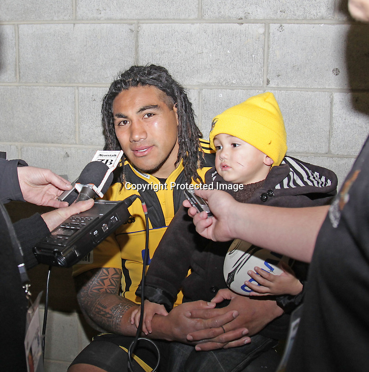 Hurricanes 38 V Lions 27 Westpac Stadium.Wellington 4.6.2011 Ma'a Nonu faces up the media with two and half year old son Mercury after team victory.bush pic 2