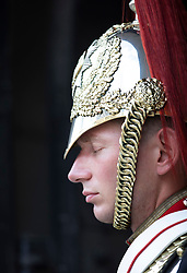 © Licensed to London News Pictures. 26/07/2018. London, UK. A member of  Household Cavalry - Blues and Royals feels the heat on duty at Horse Guards in Whitehall as London experiences the hottest day of the year so far. Photo credit: Peter Macdiarmid/LNP