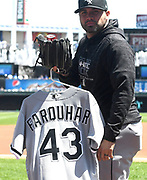 KANSAS CITY, MO - APRIL 28:  Chicago White Sox relief pitcher Hector Santiago (53) takes the jersey of ailing Chicago White Sox relief pitcher Danny Farquhar (43) to the pull pen during a MLB game between the Chicago White Sox and the Kansas City Royals on April 28, 2018, at Kauffman Stadium, Kansas City, MO. (Photo by Keith Gillett/Icon Sportswire)