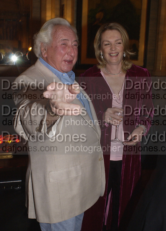 Michael Winner and Lady lloyd Webber, Krug Christmas party, hosted by Sir Trevor Nunn and Imogen Stubbs, the Criterion, 10 December 2003. © Copyright Photograph by Dafydd Jones 66 Stockwell Park Rd. London SW9 0DA Tel 020 7733 0108 www.dafjones.com
