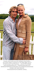 Model JODIE KIDD and MR TARQUIN SOUTHWELL, at a polo match in Surrey on 11th May 2003.	PJK 17