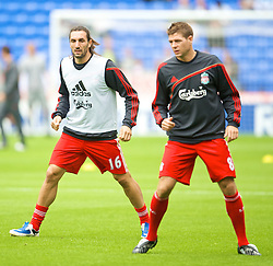 BOLTON, ENGLAND - Saturday, August 29, 2009: Liverpool's Sotirios Kyrgikaos warms-up with team-mate captain Steven Gerrard MBE before the Premiership match against Bolton Wanderers at the Reebok Stadium. (Photo by David Rawcliffe/Propaganda)