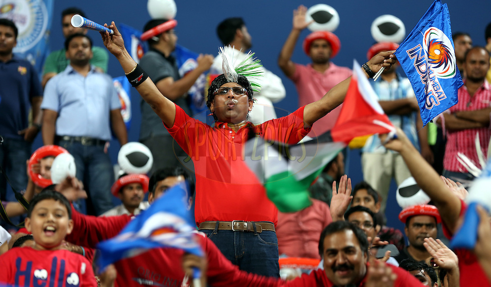 A fan of Mumbai Indians  during match 1 of the Pepsi Indian Premier League Season 7 between the Mumbai Indians and The Kolkata Knight Riders held at the Sheikh Zayed Stadium, Abu Dhabi, United Arab Emirates on the 16th April 2014<br /> <br /> Photo by Sandeep Shetty/ IPL / SPORTZPICS