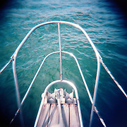 """We were sailing quietly across Long Island Sound on the way to Block Island.  I took the time to snap away, enjoying the quiet solitude of the endless blue sea.  I grew up using film cameras and have never lost the love of analog photography.  This shot was from my first roll of color film with the Holga """"toy"""" camera and I fell in love immediately."""