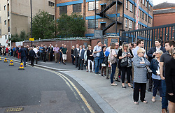 © Licensed to London News Pictures. 21/05/2019. London, UK. People queue outside Olympia in London ahead of Brexit Party leader Nigel Farage's European Election Rally. Voters are due to go to the polls in two days. Photo credit: Peter Macdiarmid/LNP