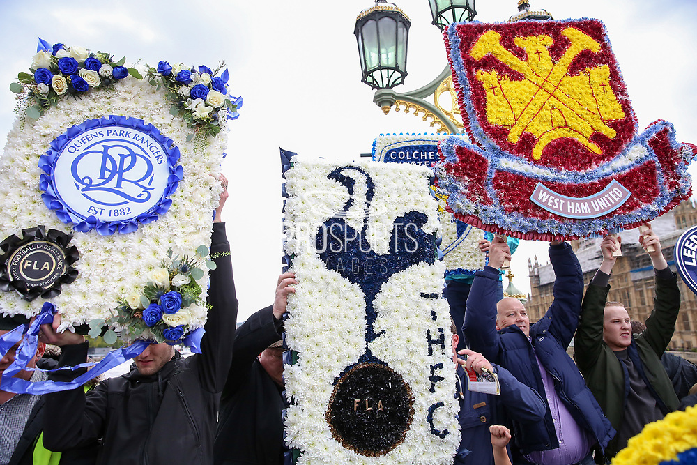 Queens Park Rangers, Tottenham and West ham wreaths during the Football Lads Alliance march between Park Lane and Westminster Bridge, London on 7 October 2017. Photo by Phil Duncan.