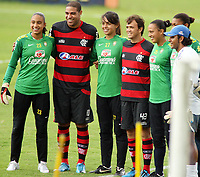 20091203: TERESOPOLIS, BRAZIL - Flamengo training at Granja Comary Training Center, in Teresopolis. With one round left to the end of the Brazilian League, Flamengo is leading the championship. In picture: Adriano and Petkovic with brazilian female football players. PHOTO: CITYFILES