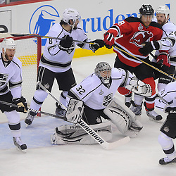 June 2, 2012: A crowd gathers around Los Angeles Kings goalie Jonathan Quick (32) to defend him from New Jersey Devils right wing Dainius Zubrus (8) during first period action in game 2 of the NHL Stanley Cup Final between the New Jersey Devils and the Los Angeles Kings at the Prudential Center in Newark, N.J.