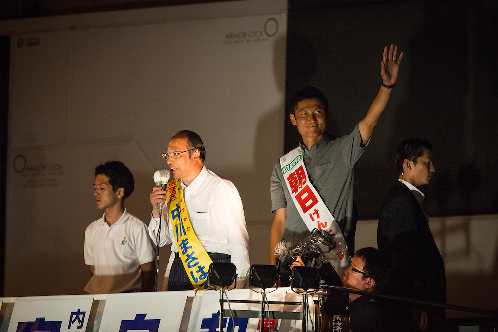 TOKYO, JAPAN - JULY 9 : Masaharu Nakagawa (left) and Kentaro Asahi (right) both candidate from Liberal Democratic Party (LDP), delivers a campaign speech during the last day of Upper House election campaign outside of Akihabara Station in Tokyo, Japan on July 9, 2016. Tomorrow, July 10, 2016 will be the first Upper house election nation-wide in Japan that 18 years old can vote after government law changes its voting age from 20 years old to 18 years old. (Photo by Richard Atrero de Guzman/NURPhoto)