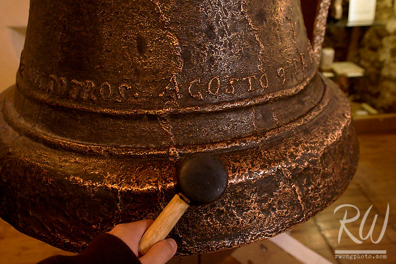 Tourist Ringing the San Jose Bell inside San Miguel Mission Chapel, Santa Fe, New Mexico