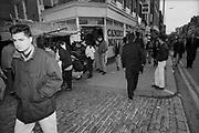 Policeman on High Street, Camden, London, UK, 1980s.