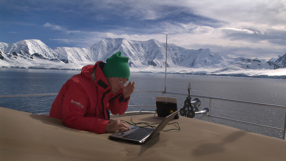 Antarctica (Jan. 17, 2007) -- Grant Wilson on the upper deck of motor yacht Whale Song using a satellite link to connect with the outside world during an expedition in Antarctica.  Photo by Johnny Bivera