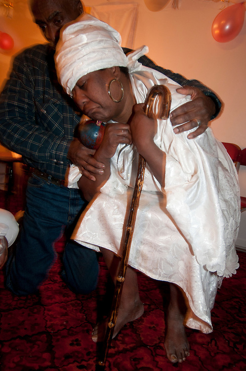 Vodoo ceremony during the winter solstice in a suburbs of Montreal.  Nirva the priestess Mambo is possessed by Legba, the spirit that link the human with the world of the spirit.