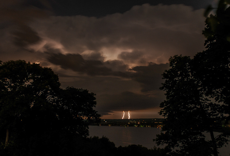 Twin lightning bolts strike along the Illinois River near Peoria.