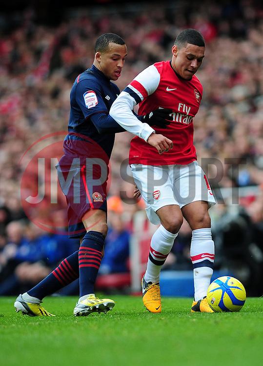 Arsenal's Alex Oxlade-Chamberlain shields the ball from Blackburn Rovers' Marcus Olsson - Photo mandatory by-line: Dougie Allward/JMP - Tel: Mobile: 07966 386802 16/02/2013 - SPORT - FOOTBALL - Emirates Stadium - London -  Arsenal V Blackburn Rovers - FA Cup - Fifth Round
