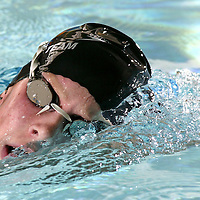 Katie Braun swims laps during a club practice at Oak Point Middle School in Eden Prairie, Minnesota on Sept. 30, 2003.(Photo By: Adam M. Bettcher)