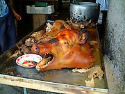 grilled pig head with mouth open, banos, ecuador