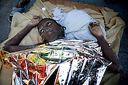 A woman, who survived the earthquake, receiving treatment by a rescue team from the Netherlands in the city of Port-au-Prince on Friday January 15, 2010.