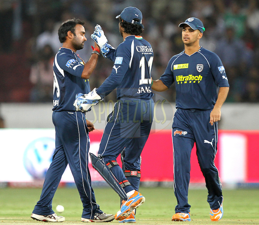 A. Mishra(L) and K. Sangakkara (C) of DC celebrates wicket of PW's Manish Pandey during match 53 of the Indian Premier League ( IPL ) between the Deccan Chargers and the Pune Warriors India held at the Rajiv Gandhi International Cricket Stadium in Hyderabad on the 10th May 2011..Photo by Prashant Bhoot/BCCI/SPORTZPICS