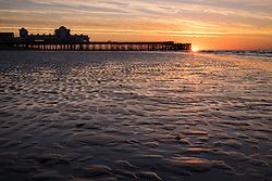 © Licensed to London News Pictures. 03/10/2016. Southsea, Hampshire, UK.  Dawn breaks as the sun rises over South Parade Pier in Southsea this morning, 3rd October 2016. People out enjoying the sunrise enjoyed a cool but clear morning on what is to be another dry and sunny autumn day in the south of England. Photo credit: Rob Arnold/LNP