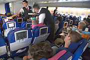 stewards providing lunch to the passengers British Airways
