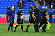 Cardiff City manager Neil Warnock looks unimpressed and annoyed as referee Craig Pawson and his assistants walk off the pitch past him at full time after controversial decisions effected the result during the Premier League match between Cardiff City and Chelsea at the Cardiff City Stadium, Cardiff, Wales on 31 March 2019.