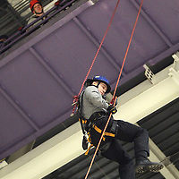 Adam Robison | BUY AT PHOTOS.DJOURNAL.COM<br /> Terry Robinson, a captain with the Tupelo Fire Department, repels down from the catwalk as other area firefighters look on. The repelling was a part of the Mississippi Task Force 1 Training held at the Bancorpsouth Arena Thursday.