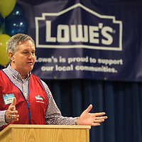 Phillip Blanchard, Lowes of Tupelo Store Manager, talks to students at Thomas Street Elementary School on Friday morning, for the announcement of a $34,408.00 grant given by the Lowe's Gives Foundation. The grant, written by Art teacher Michelle Guyton, will provide funding for the Play to Learn Project at Thomas Street Elementary School where two playgrounds will be built.