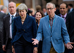 © Licensed to London News Pictures. 02/10/2017. Manchester, UK. British prime mi sister THERESA MAY and her husband PHILIP MAY seen on the second day of the Conservative Party Conference. The four day event is expected to focus heavily on Brexit, with the British prime minister hoping to dampen rumours of a leadership challenge. Photo credit: Ben Cawthra/LNP
