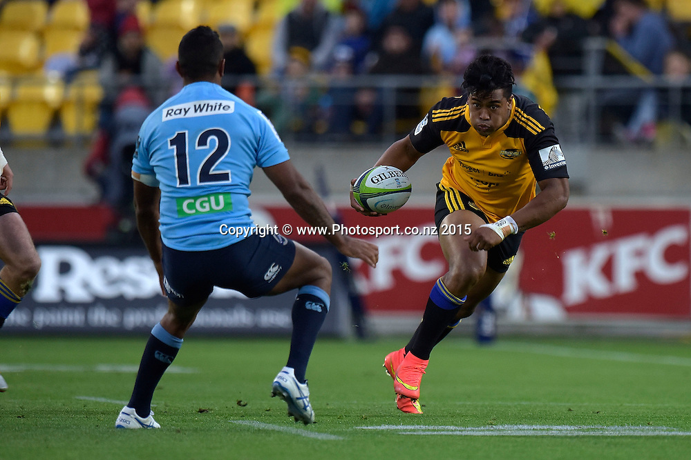 Hurricanes' winger Julian Savea (R faces Waratahs' Kurtley Beale during the Super Rugby - Hurricanes v Waratahs rugby union match at the Westpac Stadium in Wellington on Saturday the 18th of April 2015. Photo by Marty Melville / www.Photosport.co.nz