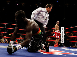 June 13, 2009; New York, NY, USA;  WBO Welterweight Champion Miguel Cotto knocks down challenger Joshua Clottey during their 12 round bout at Madison Square Garden.