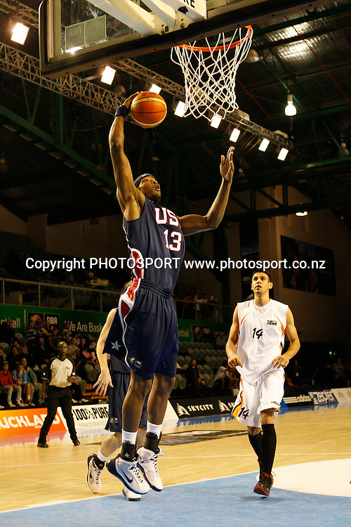 USA Forward DeAngelo Casto lays up for 2 points during the USA's 106-55 victory over Iran.<br />